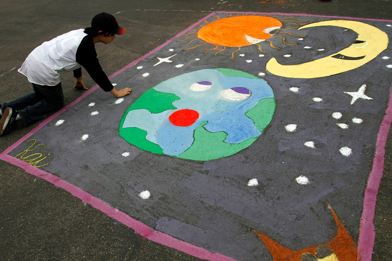 Kai, an 11 yr. old Artist mapping out his Universe