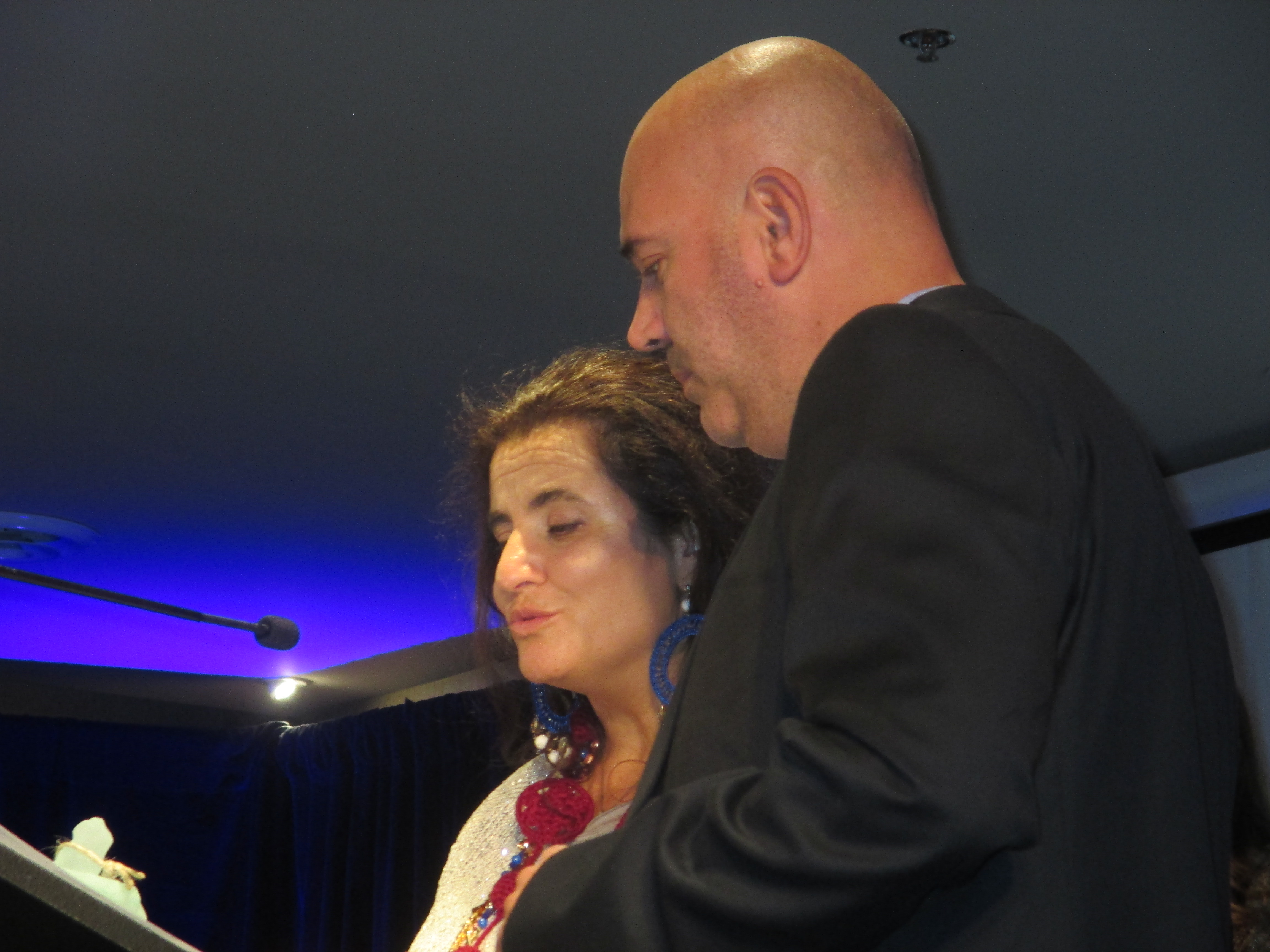 Italian Artist Lisa Perini eloquently accepting her award with brother Alessandro's translating support.