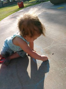 Grand daughter Sadie...starting her street painting experience at age 1!